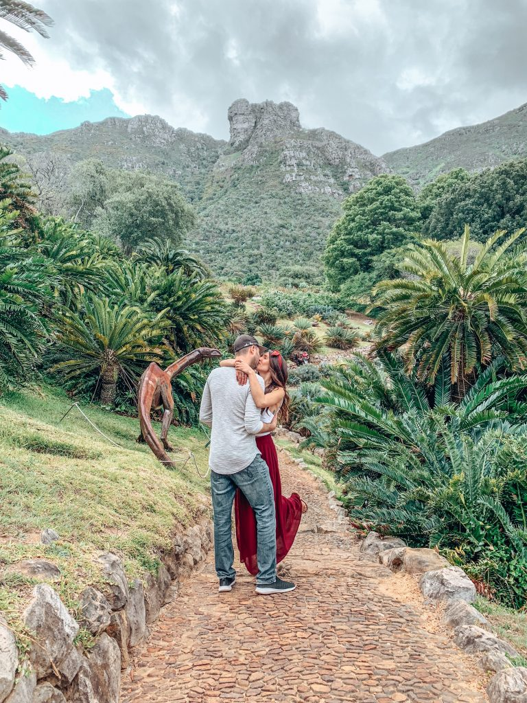 Having a kiss in the beautiful Kirstenbosch Botanical Gardens in Cape Town South Africa