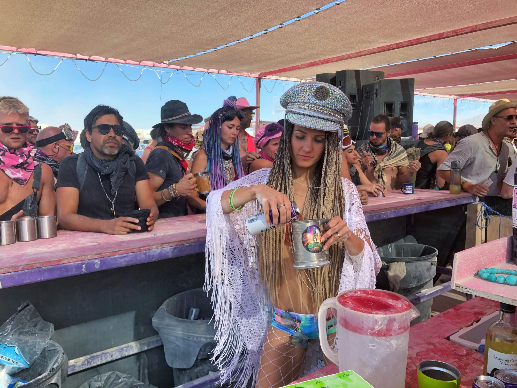 Pouring drinks at burning man pink mammoth